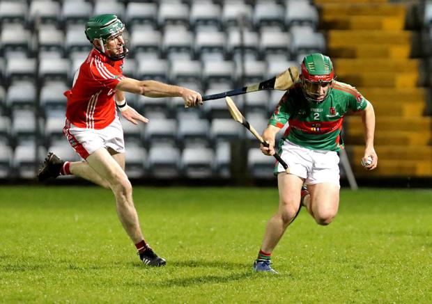 Paddy Moakley, Kilworth and Mike Millerick, Fr. O'Neills in action during their County PIHC quarter-final in Páirc Uí Rinn. Photo by Jim Coughlan