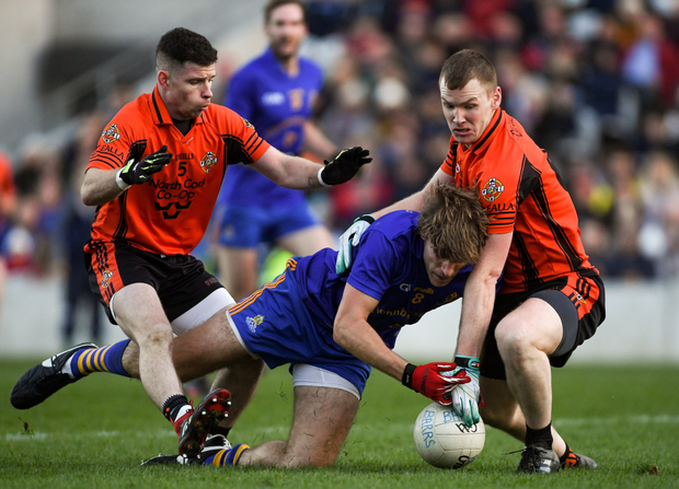 Ian Maguire of St Finbarrs in action against Lorcan O'Neill, left, and Kealan Buckley of Duhallow during the Cork County Senior Club Football Championship Final match between Duhallow and St Finbarrs at Páirc Uí Chaoimh, Cork. Photo by Piaras Ó Mídheach / Sportsfile