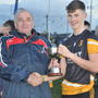 Clyda Rovers captain Conor Corbett accepts the Rebel Óg County U-16 'B' Championship Cup
