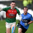 Sean O'Leary, Kilcummin chased by Alan Fitzsimmons, Kilmacthomas in the Munster GAA Intermediate Championship in Kilcummin earlier this month. Photo by Michelle Cooper Galvin