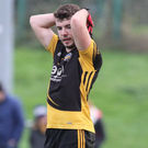 A dejected Padraig Clancy wonders what might have been at the full-time whistle after Fermoy suffered defeat to Kerry's Kilcummin in the AIB Munster Intermediate Club Football Final in Mallow. Photo: Eric Barry
