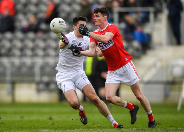 Conor Dennehy of Cork in action against Mick O'Grady of Kildare during the Allianz Football League Division 2 Round 2 match at Páirc Uí Chaoimh in Cork. Photo by Sportsfile