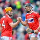 Cork players Niall O'Leary, left, and Darragh Fitzgibbon celebrate after the Munster GAA Hurling Senior Championship Round 2 match between Limerick and Cork at the Gaelic Grounds in Limerick. Photo by Piaras Ó Mídheach/Sportsfile