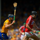 Darragh Fitzgibbon of Cork in action against David McInerney of Clare during the Munster GAA Hurling Senior Championship Final match in Semple Stadium last July. Photo by Ray McManus / Sportsfile