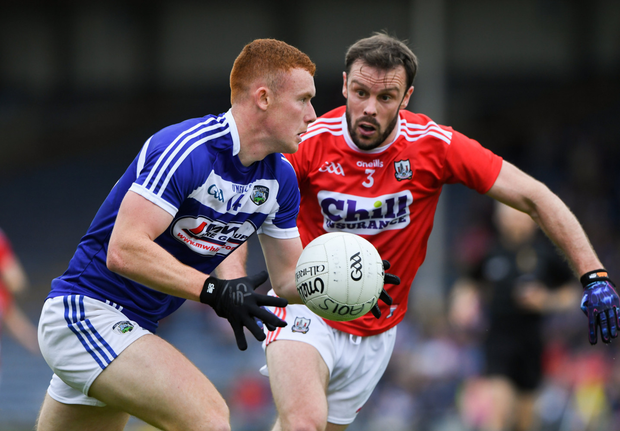 Colm Murphy of Laois in action against James Loughrey of Cork their All-Ireland SFC Round 4 Qualifier at Semple Stadium in Thurles. Photo by Sportsfile