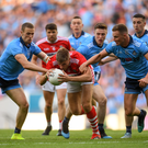 Cork's Ian Maguire is tackled by Paul Mannion, left, and Ciarán Kilkenny of Dublin during the All-Ireland SFC Quarter-final Group 2 Phase 1 match at Croke Park in Dublin. Photo by Sportsfile