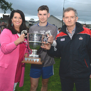 Marion Creedon Hegarty presents the Tom Creedon Cup to Cill na Martra captain Shane Ó Duinnín in the presence of Co. Cultural Officer Richard Murphy following a victory over Knocknagree. Picture John Tarrant