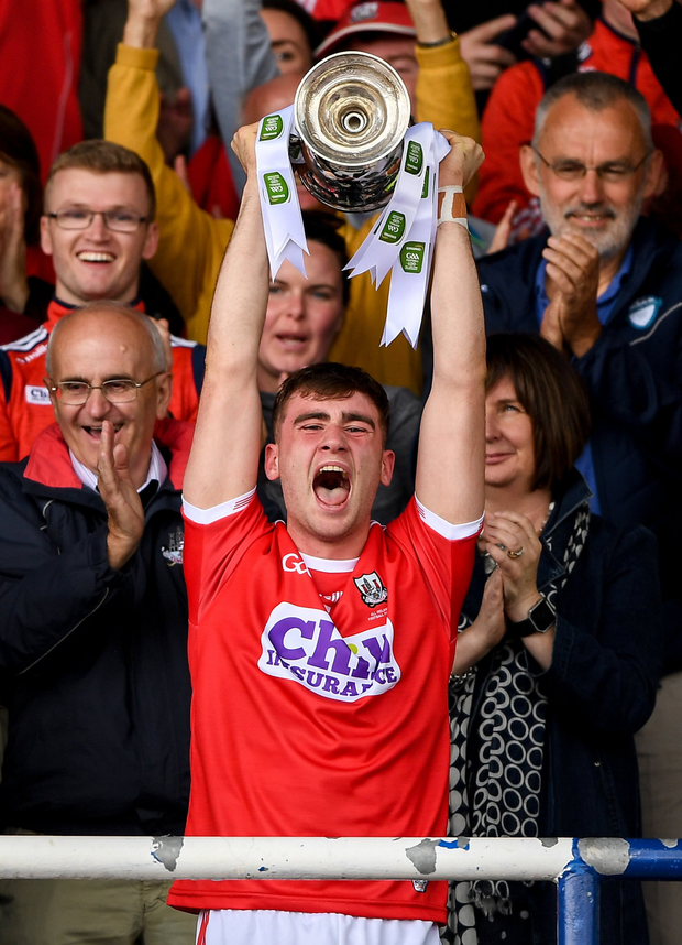 Cork captain Peter O'Driscoll lifts the cup