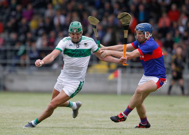 Kanturk's Aidan Walsh takes on Erins Own's Cormac Dooley during last weekend's County Senior Hurling Championship clash in Mallow. Photo by Eric Barry