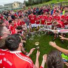 Iveleary's Captain, Cathal Vaughan and the team dance around the Mick Dunne Cup after winning the Junior A Football Championship Final played at Macroom GAA grounds on Sunday