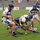 Gavin Morrissey, Eugene O'Leary and Maurice O'Sullivan, Ballyhea in action against Padraic Hogan, Carrigtwohill during their County SHC clash in Páirc Uí Rinn last Sunday afternoon. Photo by Jim Coughlan