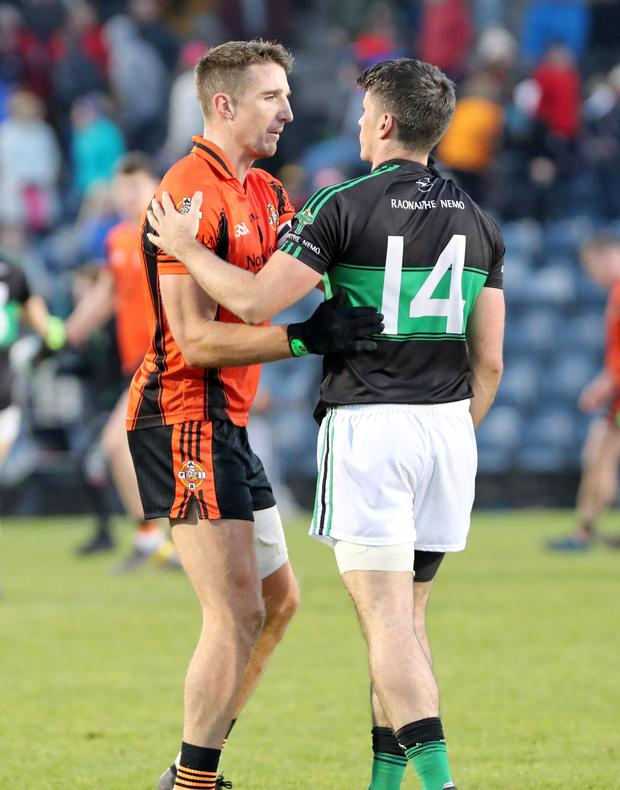 Aidan Walsh, Duhallow and Barry O'Driscoll, Nemo Rangers at the end of the County Senior Football Final in Páirc Uí Chaoimh on Sunday afternoon. Photo by Jim Coughlan