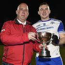 Knocknagree captain Garry O'Connor accepts the Co. IFC Cup from Joe Blake, PRO, Cork Co. Board. Picture John Tarrant