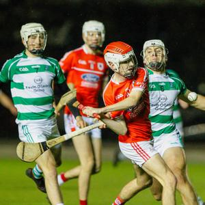 Charleville's Evan O'Connor gets a shot away as Fr. O'Neills' William Hurley tries to hook him during last weekend's County U21 Premier 2 Hurling Championship Quarter Final at Pairc Ui Chaoimh. Photo: Eric Barry
