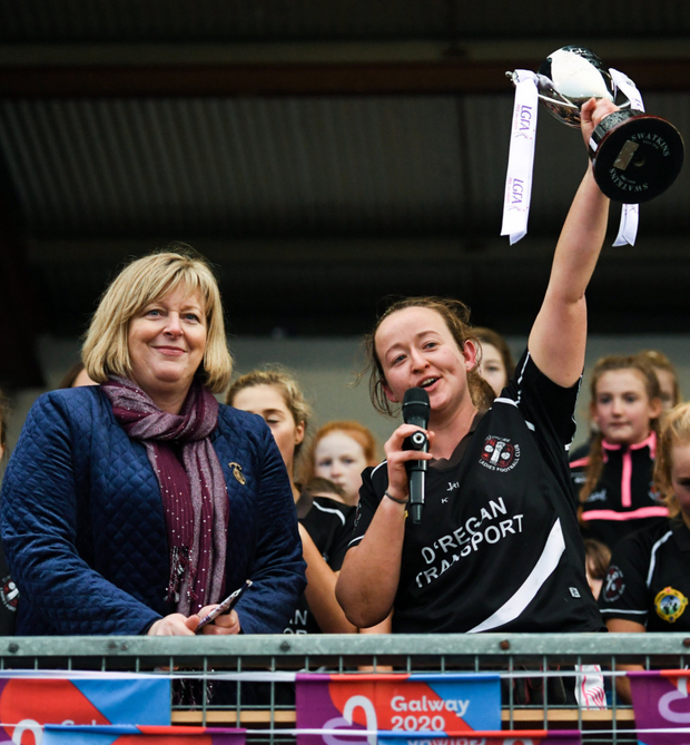Donoughmore captain Eileen Lyons lifts the trophy following the All-Ireland Ladies Junior Club Championship Final match between Donoughmore and MacHale Rovers at Duggan Park in Ballinasloe. Photo by Harry Murphy / Sportsfile