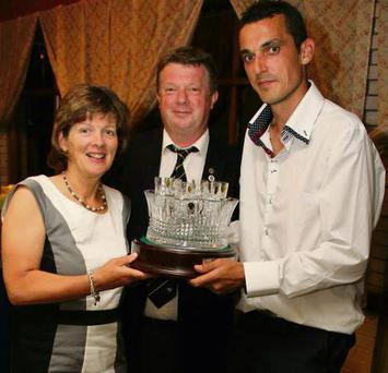 Mary Dowling presenting her husband Joe's Captain's Prize to the winner, David Forde.