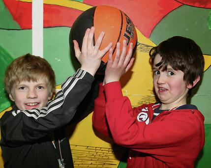 Josh Fogarty, Rathcoole, and Olan Corkery, Banteer, getting ready to try out the new Basketball Court after the official opening last Saturday evening. Photo by Sheila Fitzgerald.