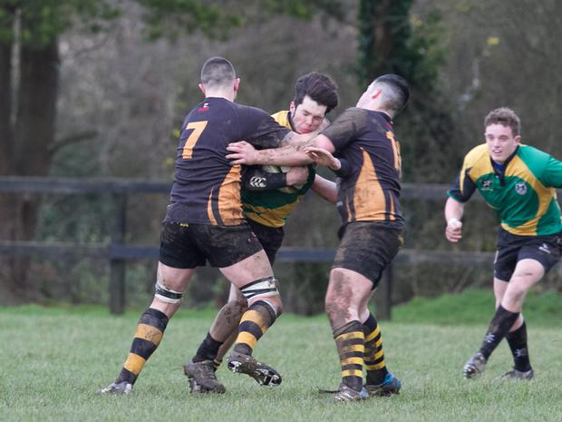 Mallow's Tadgh O'Connor is stopped in his tracks by the combined tackle from two Clanwilliam players as the sides met in the Junior Clubs Challenge Shield last weekend. Photo: Eric Barry