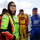 DAYTONA BEACH, FL - FEBRUARY 22: (L-R) Danica Patrick, driver of the #10 GoDaddy Chevrolet, Landon Cassill, driver of the #40 CarsForSale.com Chevrolet, and Cole Whitt, driver of the #35 Speed Stick Ford, take part in pre-race ceremonies for the NASCAR Sprint Cup Series 57th Annual Daytona 500 at Daytona International Speedway on February 22, 2015 in Daytona Beach, Florida. (Photo by Jonathan Ferrey/NASCAR via Getty Images)