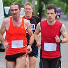 Banteer 5km winner Maurice Feehan (Gneeveguilla), right, in the company of John Barrett and John McLoughlin. Photo: John Tarrant