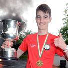 Darrragh Kiely celebrates his U-18 All-Ireland Road Bowling win at a reception in Kilcorney. Photo: John Tarrant