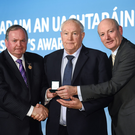 The late Tim Healy accepts his GAA President's Award for 2015 by the Uachtarán Chumann Lúthchleas Gael Liam ÓNéill, left, and Denis O'Callaghan,Head of AIB Branch Banking in Croke Park, Dublin in February 2015. Photo by Sportsfile