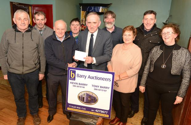 Tony Barry (Barry Auctioneers) presents sponsorship to Donie Shine, Chairman, Duhallow AC towards the inaugural Duhallow 10 mile Road Race in Newmarket. Included are Jerry Twomey, Donie Twomey, Shane Browne, Jer Murphy, Joan O'Keeffe, Margaret Hourigan and Dan Murphy. Photo by John Tarrant