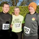 Jimmy Lenihan, Kevin Taylor, Castlemagner joined by Adrian O'Sullivan, Freemount at the Duhallow AC 5k Classic