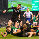 Ireland's Jacob Stockdale scores the only try of the autumn international rugby test against New Zealand at the Aviva Stadium, Dublin. The score helped Ireland to a 16-9 win, and only Ireland's second ever victory over the All Blacks and first win on Irish soil