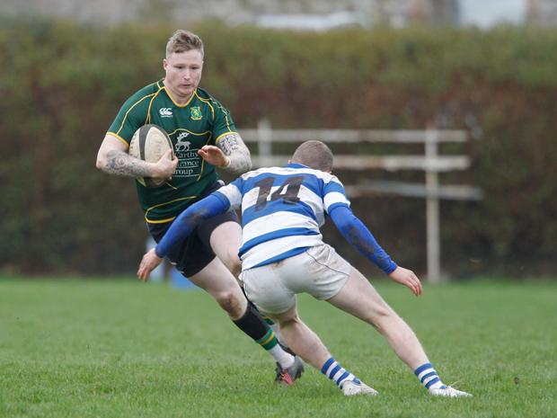 Fermoy's Dylan Foley sidesteps the challenge of Fethard & District's Gary Kavanagh during last Sunday's Munster Junior League Division 2 clash in Fermoy. Photo by Eric Barry