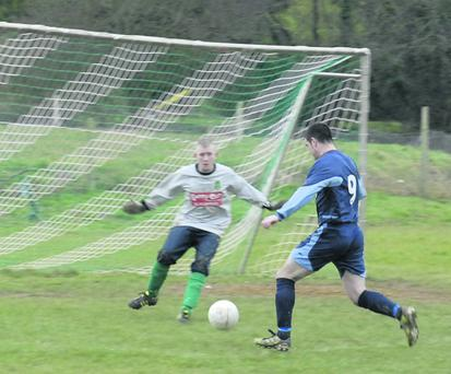 Premier A League. Kanturk V Glen Celtic Kanturks Leonard Barry about to score goal despite efforts of Glen Celtic goalie, T J Bullman