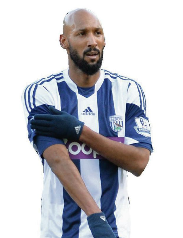 Nicolas Anelka of West Brom touches his sleeve as he celebrates scoring their first goal during the Barclays Premier League match between West Ham United and West Bromwich Albion at Boleyn Ground on December 28, 2013 in London, England. (Photo by Christopher Lee/Getty Images)