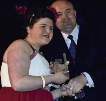 Eimear Furlong collecting her award from Declan Quinn of LCM Promotions.