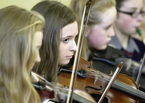 Musicians from Ardee Community School performing at Ardee Day Care Centre recently.