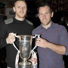 Dundalk FC players, Peter Cherrie and Mark Rossiter, with the EA Sports Cup in Jimmys Bar.