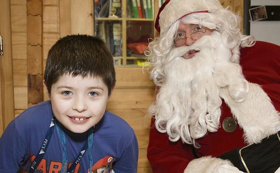 Joey Owens from Tullyallen with Santa.