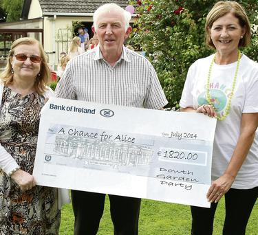 Alice's nana Lily Bohan accepts the proceeds of the garden party from Gabriel and Emily Mullen