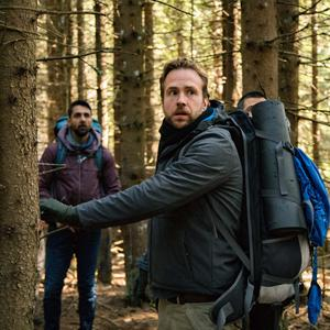 Arsher Ali as Phil and Rafe Spall as Luke in The Ritual