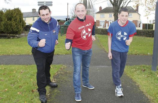 St. Mary's, Ardee and, Louth GAA Senior Football player Darren Clarke (centre) leading out the launch of the Ardee GOAL Mile at the Fairgreen, Ardee.