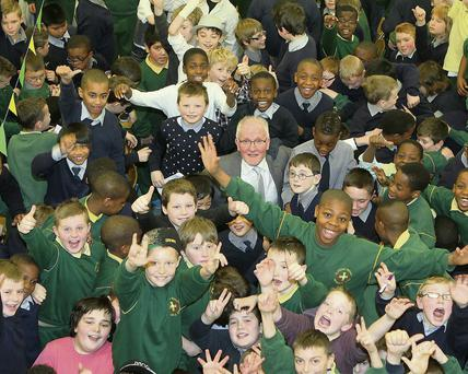 Mr. Hussey surrounded by pupils at his farewell party in the St. Joseph's.