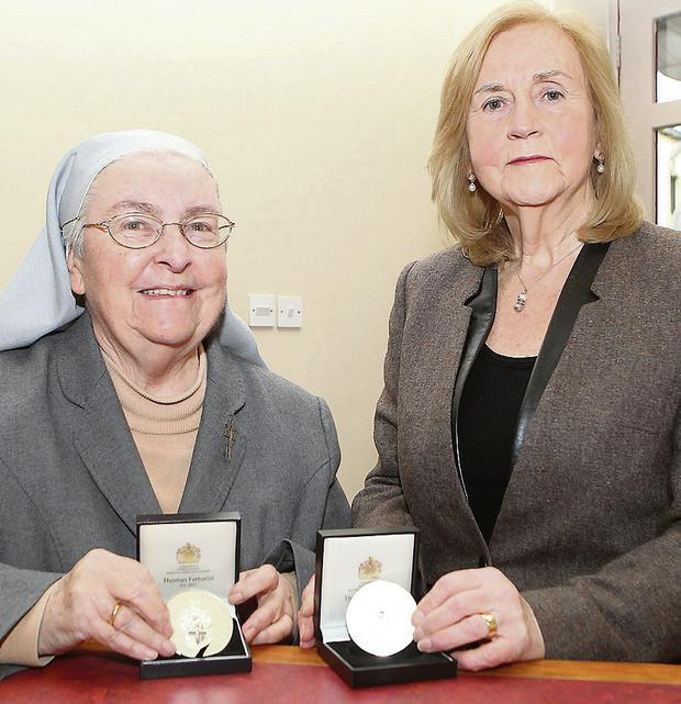 Sr Davnet O'Kane and Georgina Clarke with their medals from the Institute of Biomedical Science.