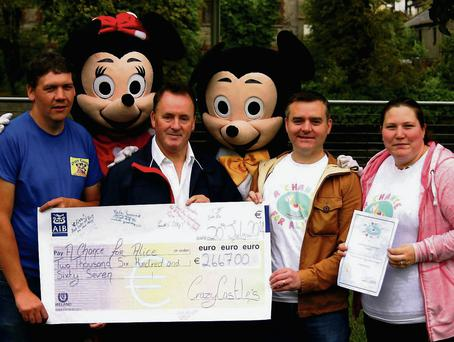 Over €2,600 is handed over to the Chance for Alice fund by the fun day organisers from CrazyCastles
