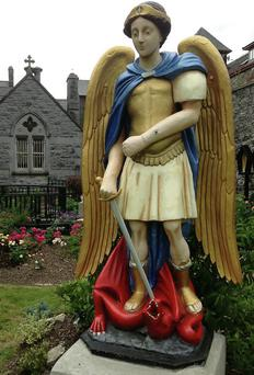 The statue of St Michael in the Dominican garden
