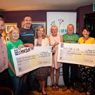 D2K committee members, presenting two cheques of €18, 500 each to MND and Paul's Fight4Life. The unbelievable sums were raised as a result of the, by now, annual cycle from Dunleer to Kilkenny in June of this year