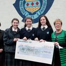 Miss E OSullivan, Rachel Ledwith, Sarah Meegan, Doireann Dullaghan, Greenhills girls, presenting a cheque to St. Vincent de Paul, Drogheda area, representative Mary Reynolds
