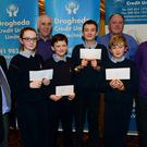 Tommy Weir, Bernard Clarke and Declan Collins with the Whitecross NS team, winners of the schools Credit Union quiz in the Ardboyne, Abigail Reddin, Ben Sweeney, Inish Maloney, Jacob Deane and Brian Colreavy, teacher