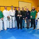 Karl Doyle , Brodie Burns, Sensei Most Senior Karate Instructor in The World, Tom Scott World Champion Fighter, Paul Sambrooks, Mayor Paul Bell, Bobby Hamilton, Martin Fogerty President WIKF, Brendan O Keef and Paddy Byrne at O Raghallaigh's GAA Club