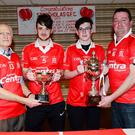 Fintan McCarthy of St Nicholas GFC presenting Under 16 captains Nathan Murphy and Vinnie O'Hare with the John Caffrey Cup at an awards ceremony at Nano Reids Restaurant; also in the picture is Philip Kirwan