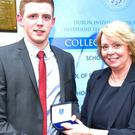 Dr. Mary Prendergast, Dublin Institute of Technology, presents the DIT Gold Medal for academic excellence to Eoghan Hurley from Balgathern in recognition of his achievement of first place on the BBS Honours Degree in Accounting and Finance
