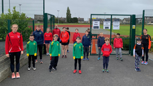 Pictured (L-R) are Drogheda & District AC Chairperson Ciara O'Reilly, Vice Chair Paul Barrell and Nicola Veale, Vice PRO Boyne Athletics Club, with juvenile members from both clubs at the Lourdes Stadium